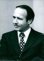 Close up of Prince Sadruddin Aga Khan, while he is looking at something with smiling face