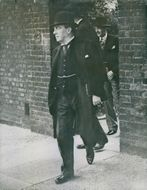 Stanley Baldwin, followed by Anthony Eden, leaving No. 10, Downing Street to lunch with the delegates at a London restaurant.