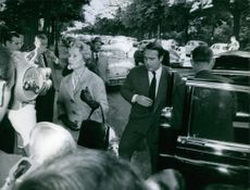 Prince Sadruddin Aga Khan with his mother Andree getting out of the car.