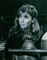 A photo of Joanna Shimkus and holding a guage. Photo taken in October 1966.