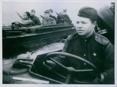 """Russian and Polish soldiers sitting on the boat and moving.""""Russian and Polish soldiers in Poland. Unrecognized people.""""1939"""