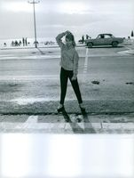 German film actress and singer, Marion Michael striking a pose beside a road.