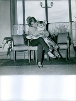 Marion Michael posing with a tiger doll.