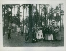 A group of Polish children are seen here in one of the open air schools receiving instructions from their German school masters during ruling time of Wilhelm II