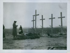 Russian graves in 1914  These rough wooden crosses mark the graves of five Russian Captains who were killed together by a machine gun which the Germans had hidden on a church.