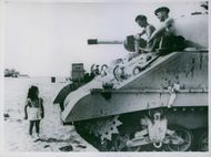 Rita Richards ran up to a tank that was being repaired and looked up at the surprised members of the crew.