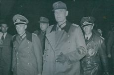 Lieutenant-General Erich Stahl leads Lieutenant-General Heinrich Kirchein and other senior German officers. 1945.