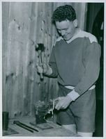 Member of the Hammarby Football repairing a shoe, 1939.