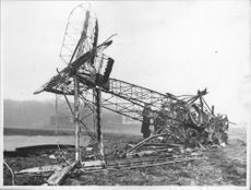 A wreck from a crashed Danish naval aircraft in the vicinity of Gothenburg.Men inspecting the former air machine.