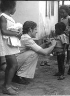 Clothes from Swedish donors handed out by the Red Cross to needy children in Angola.