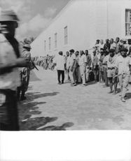 Men in Congo were being searched by the military men.