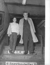 Young actress Joëlle Jacquet going down the stairs with an old man.