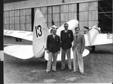 Flying Trio in front of their Airspeed Envoy plane prepare for the upcoming Johannesburg Race.
