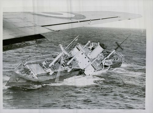 An aerial view of the stricken ship taken from a Royal Air Force plane, showing the Flying Enterprise badly listing over on the port side. 1952.