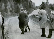Three men walking ahead of the detectives as they get arrested. 1959