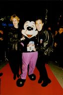 Melanie Griffith and Antonio Banderas with Mickey Mouse at the opening Planet Hollywood in Disneyland, Paris.