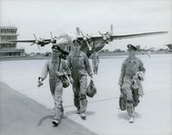 Military officers arriving at the airport tarmac in Zambia. 1965.