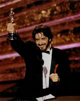 Al Pacino proudly showing off his trophy.
