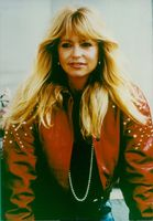 US actress, Goldie Hawn, wearing a red leather jacket.