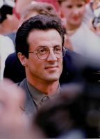 Sylvester Stallone wearing glasses in Cannes. 1990.