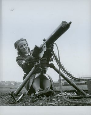 Female soldier manning an anti-aircraft gun. 1943.