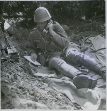 A soldier giving a report on the telephone during war. 1939