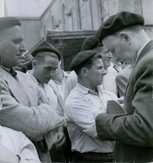 Group of men gathered in the streets.