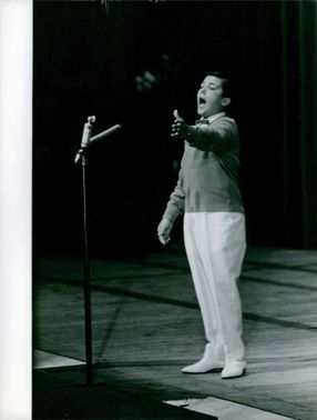 boy performing on stage no name.