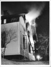 Fire in the two-story wood.