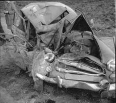 Heavily damaged car after a collision.