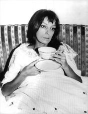 Marie Laforêt holding cup.