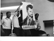 People holding picture of Pierre Lagaillarde.