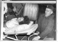One of the seven injured wife Lizzy Odelmar is taken out of the burning chocolate factory Nissen in Norrköping