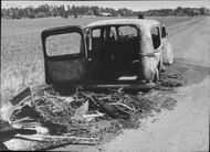 Remains of a hearse that caught fire on Väddö road north of Norrtälje, drivers and passengers had time to throw out and escaped unharmed