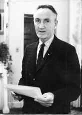 Mike Mansfield with papers.