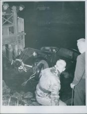 Police and firefighter trying to get the car driving down the Djurgårdsbrunn channel bottom