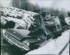 Heavily damaged passenger car and truck after a collision