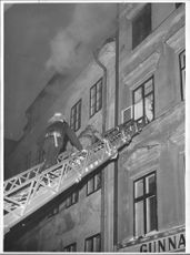Firefighters at work at the fire on Österlånggatan in the Old Town.