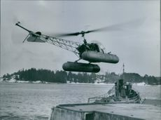 Helicopter takes off from the winter port of Stavnäs to retrieve provinsialläkare John Bellander that was left at the scene of the accident