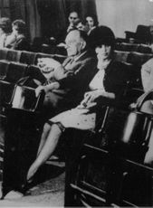 Film director Fritz Lang sitting as an audience in a theater with a woman.