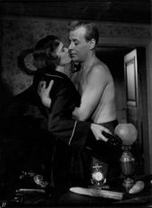 Hasse Ekman leaning close to Eva Henning in Gabrielle. 1954.