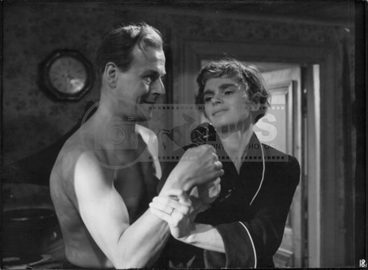 "Swedish director and actor Hasse Ekman and actress Eva Henning together in a scene of 1954's film ""Gabrielle"""