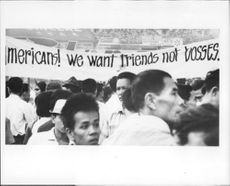 "A protest in Vietnam saying ""Americans! We want friends not bosses"""