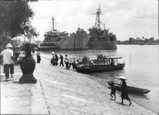 People strolling on the port of Saigon.