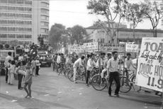 Crowd making a protest in the streets of Hanoi, Vietnam.