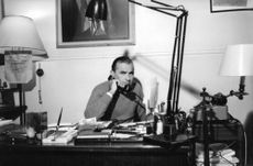 Raoul Levy  talking on the telephone.
