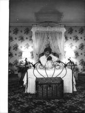 Gypsy Rose Lee sitting on her bed.