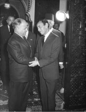 King Hassan II of Morocco shook hands of a gentleman as he was received upon arrival.