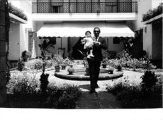 King Hassan II with his child.