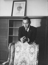 King Hassan II leaning on the chair.